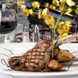 Stock Photo: Veal Chop dinner and wine