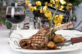 Veal Chop dinner and wine — Stock Photo