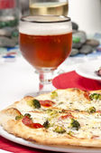 Pizza and glass of beer — Stock Photo