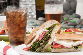 Sandwich and refreshments — Stock Photo