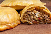 Open beef empanada — Stock Photo