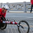 Racing in wheelchair — Stock Photo