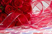 Red Roses and Ribbon — Stock Photo