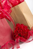 Saint Valentine gifts and roses — Stock Photo