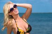 Beautiful blond woman enjoying the seaside — Stock Photo