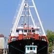Tugboat and Cargo Ship — Stock Photo