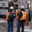 Construction workers chatting at construction site in ground zero — Stock Photo