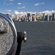 Stock Photo: New York Skyline and Telescope