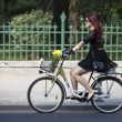 Woman riding a bicycle in Bucharest — Stock Photo