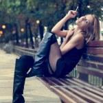Beautiful sexy woman smoking a cigarette — Stock Photo #29141159