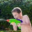 Kid playing with water toys in backyard. — Stock Photo