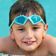 Kid in the swimming pool — Stock Photo