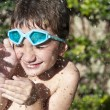Kid playing with water — Stock Photo