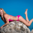 Happy woman in swimsuit at the beach — Stock Photo