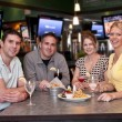 Friends in the bar — Stockfoto