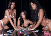 Girls playing poker — Stock Photo