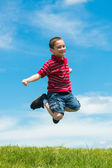 Kid jumping high outdoors — Stock Photo