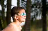 Portrait of kid in backyard and pool. — Stock Photo
