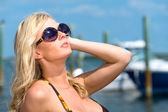 Woman enjoys the summer with boats behind. — Stock Photo