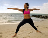 Yoga pose in the beach — Stock Photo