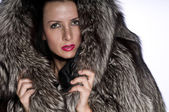 Beautiful woman with fur — Stock Photo