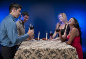 Group of friends drinking wine — Stock Photo