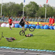 Demonstration performances of athletes on a green field of stadium — Foto de Stock