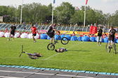 Demonstration performances of athletes on a green field of stadium — Stock Photo
