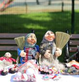 The Mordovian dolls with brushes and money in hands — Zdjęcie stockowe