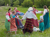 Round dance of girls in the Russian national dresses — Stock Photo