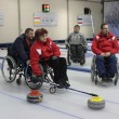 Team of young disabled people on game in curling — Stockfoto #31966635