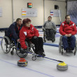 Team of young disabled people on game in curling — Stock fotografie #31966635