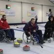 Постер, плакат: Team of young disabled people on game in curling