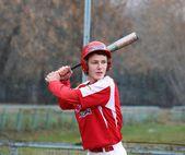 The baseball player with a baseball bat at stadium — Stock Photo