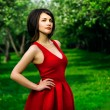 Model girl in red dress — Stock Photo