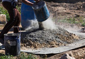 Mixing cement and sand — Stock Photo