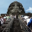 Tourists climbing up the steep steps leading to the Central Sanctuary of Angkor Wat, Siem Reap, Cambodia — Stock Video