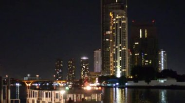 Chao Phraya River skyline and a river ferry, 8 June 2013 in Bangkok, Thailand — Stock Video
