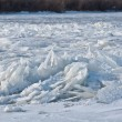 Stock Photo: Ice chunks piled up on river