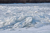 Ice chunks piled up on the river — Stock Photo