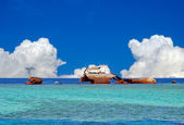 A wreck on the background of blue sky and snow-white clouds — Stock Photo