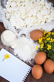 Eggs, flour, sour cream,  cottage cheese and notepads recipes — Stock Photo