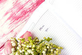 "Entry in the diary ""Miss you"" and lily of the valley and pink tu — Stock Photo"