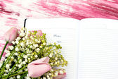 "Entry in the diary ""Miss you"" and lily of the valley — Stock Photo"