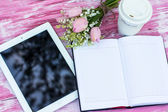 Diary, a tablet computer, a glass of coffee and  lilies of valle — Stok fotoğraf