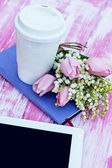 Diary, a tablet computer, a glass of coffee and  lilies of valle — Stock Photo