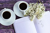 """Entry in the diary """"I love you"""", cups of coffe and branch of lil — Stock Photo"""