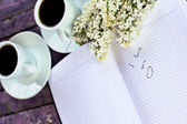 "Entry in the diary ""I love you"", cups of coffe and branch of lil — 图库照片"