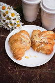 Coffee and croissant — Stock Photo