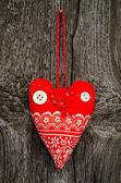 Handmade red fabric heart — Stock Photo